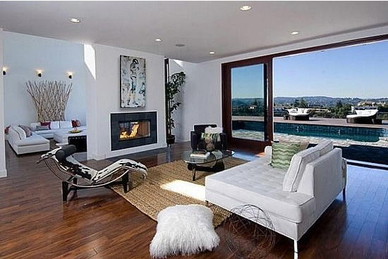 Rihannas-sitting-room-features-a-360-degree-fireplace-and-overlooks-her-infinity-pool